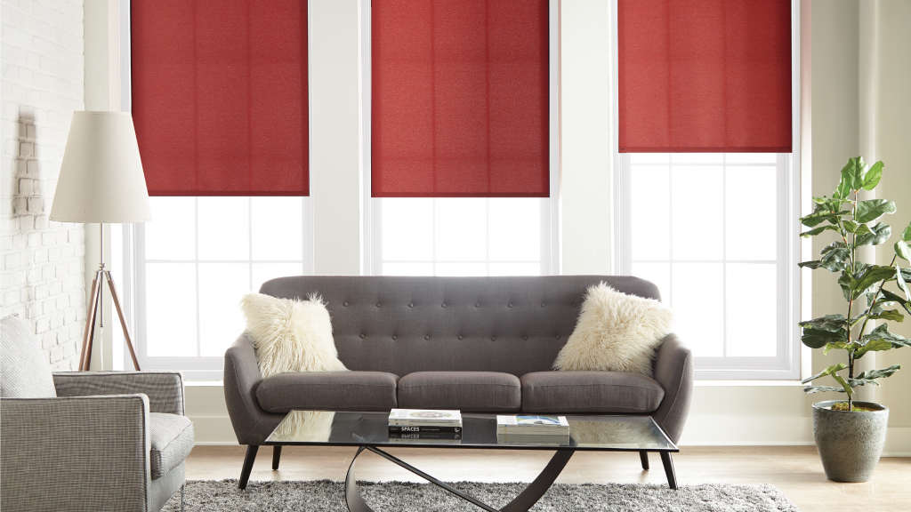 Light-filtering designer fabric roller shades, perfect for the comfort of a living room in need of soft light