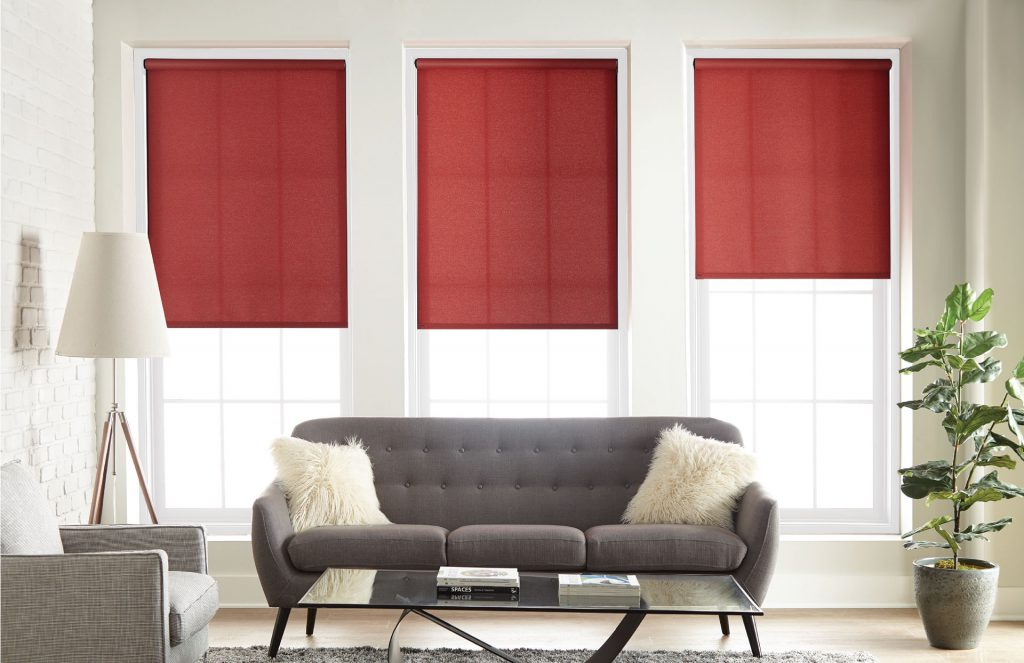 Light-filtering roller shades, perfect for a living room in need of soft, natural light