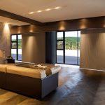 Vertical room-darkening cellular shades on doors